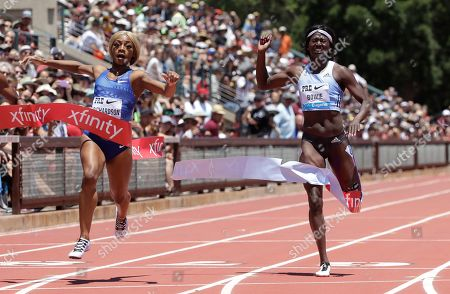 Sha'Carri Richardson, left, and Tori Bowie, both of the United States, compete in the women's 100-meter race during the Prefontaine Classic, an IAAF Diamond League athletics meeting, in Stanford, Calif