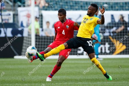 Fidel Escobar, Junior Flemmings. Panama's Fidel Escobar, left, and Jamaica's Junior Flemmings battle for the ball during the first half of a CONCACAF Gold Cup soccer match, in Philadelphia