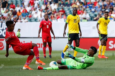 Edgar Barcenas, Andre Blake. Panama's Edgar Barcenas, left, cannot get a shot past Jamaica's Andre Blake during the first half of a CONCACAF Gold Cup soccer match, in Philadelphia