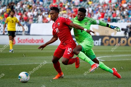 Andre Blake, Edgar Barcenas. Panama's Edgar Barcenas, left, tries to keep Jamaica's Andre Blake away from the ball during the first half of a CONCACAF Gold Cup soccer match, in Philadelphia