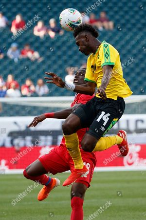 Abdiel Arroyo, Shaun Francis. Jamaica's Shaun Francis, right, leaps for the ball past Panama's Abdiel Arroyo during the first half of a CONCACAF Gold Cup soccer match, in Philadelphia