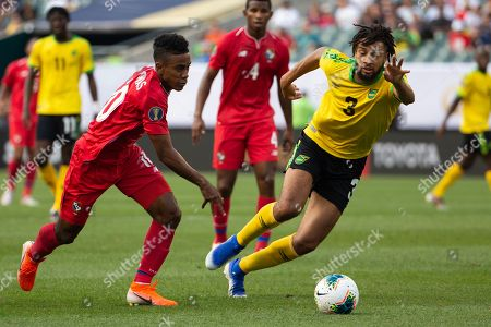 Panama midfielder Edgar Barcenas (10) brings the ball up the pitch against Jamaica defender Michael Hector (3) during the CONCACAF Gold Cup quarterfinal match between Jamaica and Panama at Lincoln Financial Field in Philadelphia, Pennsylvania