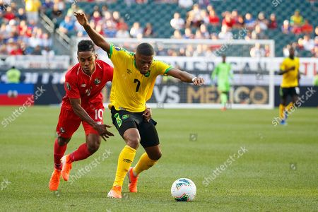 Jamaica forward Leon Bailey (7) goes after the ball as Panama midfielder Edgar Barcenas (10) fouls him during the CONCACAF Gold Cup quarterfinal match between Jamaica and Panama at Lincoln Financial Field in Philadelphia, Pennsylvania. Jamaica won 1-0 to advance