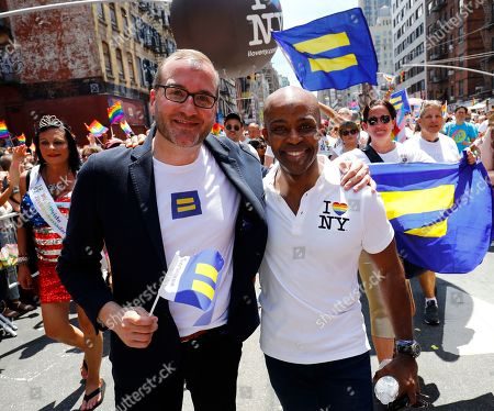 Human Rights Campaign President Chad Griffin (L) and Incoming President Alphonso David march in the New York City Pride March, in New York. David will be the first civil rights lawyer and first person of color to lead the nation's largest LGBTQ civil rights organization