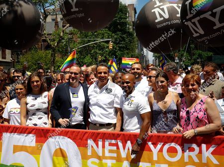 Stock Picture of New York State Gov. Andrew Cuomo is joined by Human Rights Campaign president Chad Griffin (2nd, L) and incoming president Alphonso David (3rd, R) along with former New York City Council speaker Christine Quinn (R) for the New York City Pride March, in New York. David will be the first civil rights lawyer and first person of color to lead the nation's largest LGBTQ civil rights organization