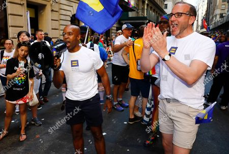 Human Rights Campaign Incoming President Alphonso David (L) and President Chad Griffin encourage the crowd before marching in the New York City Pride March, in New York. David will be the first civil rights lawyer and first person of color to lead the nation's largest LGBTQ civil rights organization