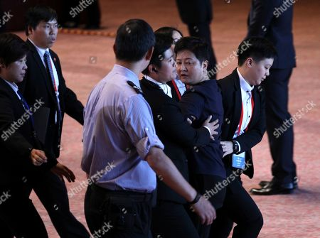 Lawmaker Helena Wong (2-R) is escorted out of the venue after shouting for Chief Executive Carrie Lam to step down during her speech after the flag raising ceremony to mark the 22nd anniversary of Hong Kong's handover from Britain to China inside the Hong Kong Convention and Exhibition Centre in Hong Kong, China, 01 July 2019. Anti-extradition bill protesters vowed to disrupt a flag-raising ceremony on 01 July 2019. On 01 July, Hong Kong marks the 1997 transfer of sovereignty of Hong Kong from Britain to China.