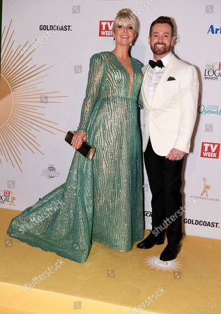 Stock Image of Grant Denyer (right) and wife Cheryl Denyer arrive at the 2019 Logie Awards at The Star Casino on the Gold Coast, Australia, 30 June 2019. ( )