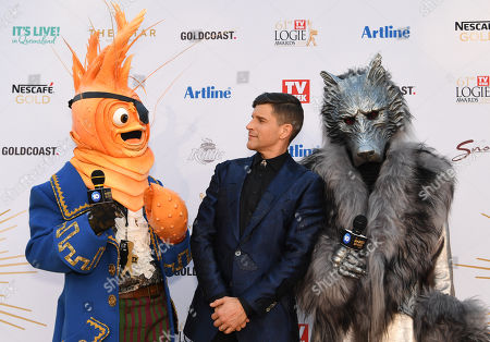 Stock Picture of Osher Gunsberg (centre) and characters from the 'The Masked Singer' arrive at the 2019 Logie Awards at The Star Casino on the Gold Coast, Australia, 30 June 2019. ( )