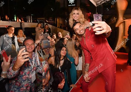 Guy Sebastian and Delta Goodrem are seen posing for selfie photographs with fans on the red carpet at the 2019 Logie Awards at The Star Casino on the Gold Coast, Australia, 30 June 2019. ( )