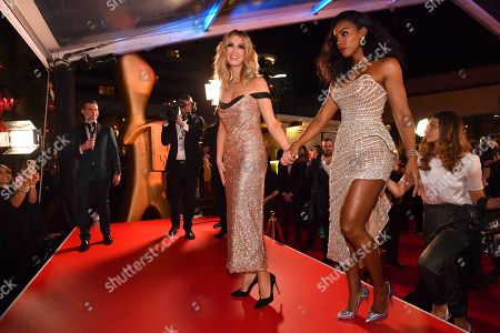 Delta Goodrem (left) and Kelly Rowland (right) are seen on the red carpet at the 2019 Logie Awards at The Star Casino on the Gold Coast, Australia, 30 June 2019. ( )