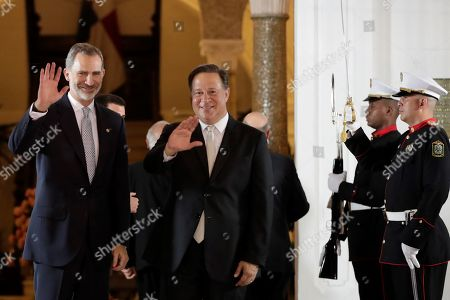 Stock Image of King Felipe VI of Spain (L) is welcomed by the Panamanian President Juan Carlos Varela (C) upon his arrival at the presidential palace of Las Garzas in Panama City, Panama, 30 June 2019. Felipe VI held a meeting with Panamanian President Juan Carlos Varela on the eve of the ceremony in which he will be relieved in the Panamanian presidency by Laurentino Cortizo.