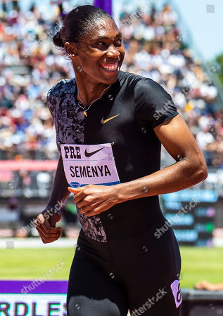 Stanford, CA : Caster Semenya wins the women's 800 Meters celebrate with fans during the Nike Prefontaine Classic at Stanford University Palo Alto, CA. Thurman James / CSM