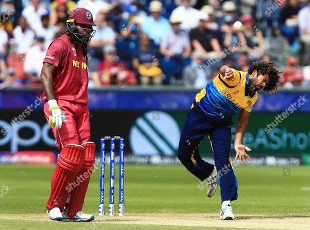 Lasith Malinga of Sri Lanka bowling next to Chris Gayle of West Indies