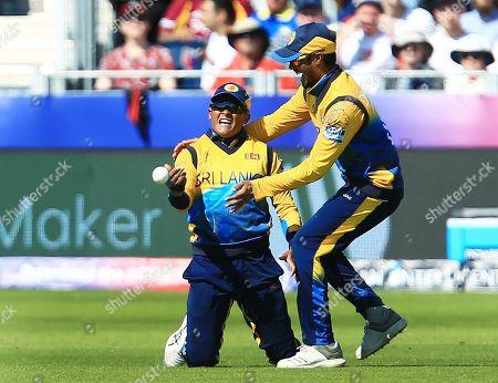 Jeffrey Vandersay of Sri Lanka celebrates taking a catch from Chris Gayle of West Indies