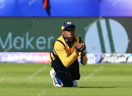 Jeffrey Vandersay of Sri Lanka takes a catch from Chris Gayle of West Indies