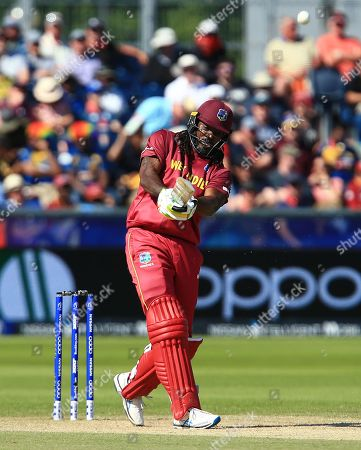 Chris Gayle of West Indies hits out to lose his wicket