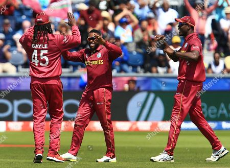 Fabian Allen of West Indies celebrates taking the wicket of Kusal Mendis of Sri Lanka with Chris Gayle
