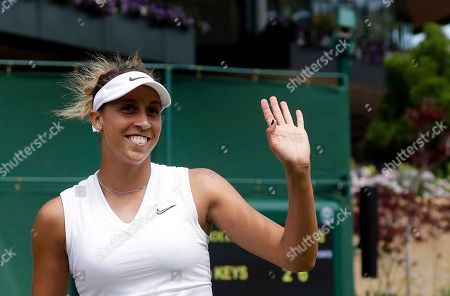 Stock Picture of United States' Madison Keys reacts after beating Thailand's Luksika Kumkhum in a Women's singles match on day one of the Wimbledon Tennis Championships in London