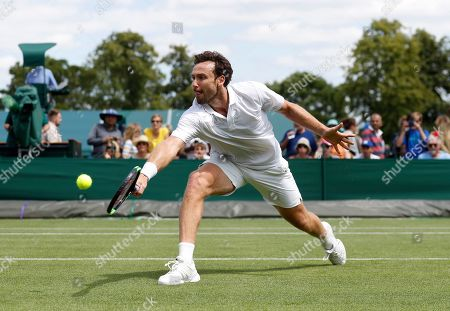 Latvia's Ernests Gulbis returns to Argentina's Leonardo Mayer during their Men's singles match on day one of the Wimbledon Tennis Championships in London