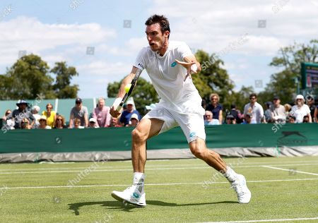 Argentina's Leonardo Mayer returns to Latvia's Ernests Gulbis during their Men's singles match on day one of the Wimbledon Tennis Championships in London