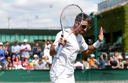 Serbia's Janko Tipsarevic reacts after beating Japan's Yoshihito Nishioka during day one of the Wimbledon Tennis Championships in London