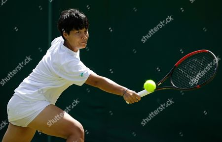 Thailand's Luksika Kumkhum returns to United States' Madison Keys during their Women's singles match on day one of the Wimbledon Tennis Championships in London