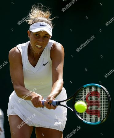 United States' Madison Keys returns to Thailand's Luksika Kumkhum during their Women's singles match on day one of the Wimbledon Tennis Championships in London