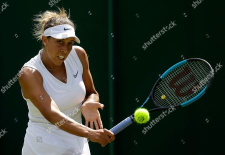 Stock Image of United States' Madison Keys returns to Thailand's Luksika Kumkhum during their Women's singles match on day one of the Wimbledon Tennis Championships in London
