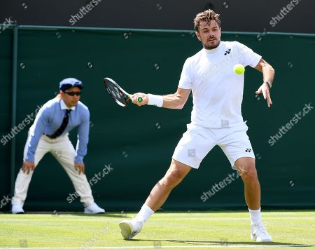 Stan Wawrinka of Switzerland in action against Ruben Bemelmans of Belgium during their first round match at the Wimbledon Championships at the All England Lawn Tennis Club, in London, Britain, 01 July 2019.