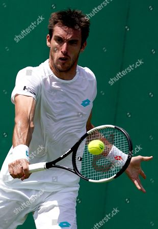 Leonardo Mayer of Argentina in action against Ernests Gulbis of Latvia during their first round match at the Wimbledon Championships at the All England Lawn Tennis Club, in London, Britain, 01 July 2019.
