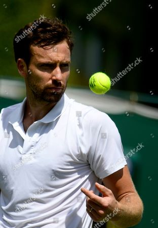 Stock Photo of Ernests Gulbis of Latvia in action against Leonardo Mayer of Argentina during their first round match at the Wimbledon Championships at the All England Lawn Tennis Club, in London, Britain, 01 July 2019.