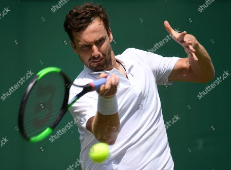 Ernests Gulbis of Latvia in action against Leonardo Mayer of Argentina during their first round match at the Wimbledon Championships at the All England Lawn Tennis Club, in London, Britain, 01 July 2019.