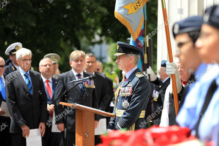 Stock Image of Chief of the Air Staff, Air Chief Marshal Sir Stephen Hillier pictured alongside Bomber Command veterans at the RAF Benevolent Fund service at the Bomber Command Memorial in London