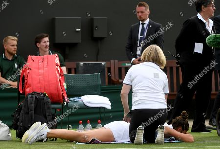Sara Sorribes Tormo of Spain receives medical treatment during her first round match against Caroline Wozniacki of Denmark at the Wimbledon Championships at the All England Lawn Tennis Club, in London, Britain, 01 July 2019.