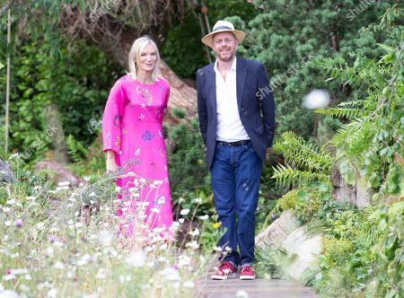 Television presenters, Jo Whiley and Joe Swift, in The RHS 'Back to Nature Garden', designed by HRH The Duchess of Cambridge with Andree and Adam White.