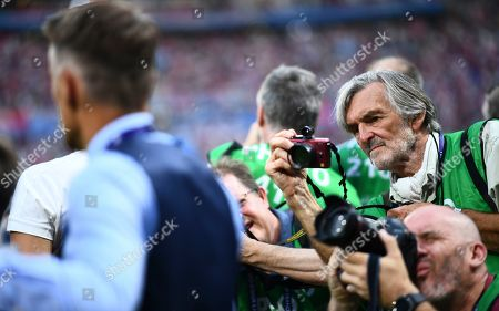 Stock Picture of Photographers take pictures of England Head Coach Phil Neville during the national anthem, including veteran Peter Robinson, centre right