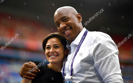 BBC pundit Dion Dublin poses for a photo with reporter Eilidh Barbour before kick off