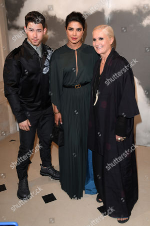 Nick Jonas, Priyanka Chopra and Maria Grazia Chiuri in the fron row