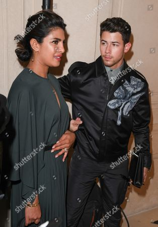 Priyanka Chopra (holding her tummy) and Nick Jonas in the front row