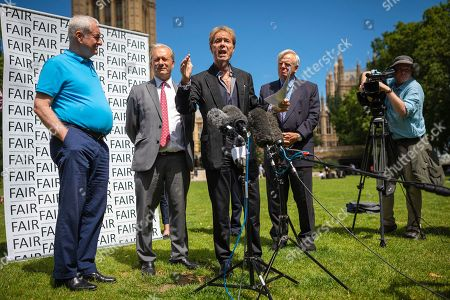 Sir Cliff Richard (centre) joins Paul Gambaccini (L), Daniel Janner QC (2-L) and Lord Grade (2-R) at the launch of a campaign calling for a ban on naming sex crime suspects unless they have been charged.
