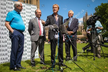 Stock Image of Sir Cliff Richard (centre) joins Paul Gambaccini (L) and others at the launch of a campaign calling for a ban on naming sex crime suspects unless they have been charged.