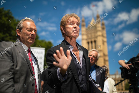 Sir Cliff Richard (centre) joins Paul Gambaccini and others at the launch of a campaign calling for a ban on naming sex crime suspects unless they have been charged.