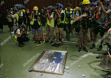 A defaced portrait of Andrew Leung, Chairman of the Legislative Council is seen on the floor after protesters break the Legislative Council building during the annual 01 July pro-democracy march Hong Kong, China, 01 July 2019. Protesters are demanding the resignation of Hong Kong Chief Executive Carrie Lam and the full withdrawal of a suspended extradition bill to China. On 01 July, Hong Kong marks the 1997 transfer of sovereignty of Hong Kong from Britain to China.