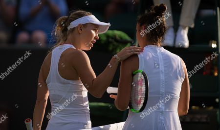 Caroline Wozniacki of Denmark & Sara Sorribes Tormo of Spain at the net after Sorribes Tormo is forced to retire from their first round match