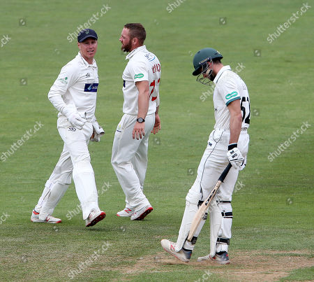 David Lloyd of Glamorgan celebrates with Tom Cullen after he caught Joshua Dell.