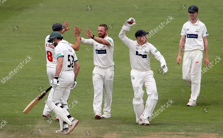 David Lloyd of Glamorgan celebrates with Graham Wagg after Joshua Dell is caught by Tom Cullen.