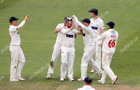 David Lloyd of Glamorgan celebrates with team mates after Joshua Dell is caught by Tom Cullen.
