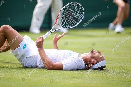 Ruben Bemelmans of Belgium slips during the men's singles first round match