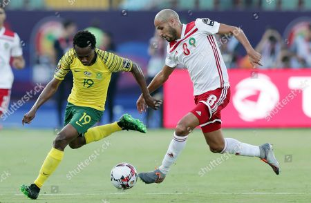 South African player Percy Tau (L) in action against Morocco's Karim El Ahmadi during the 2019 Africa Cup of Nations (AFCON) group D soccer match between South Africa and Morocco at  Al-Salam Stadium in Cairo, Egypt, 01 July 2019.